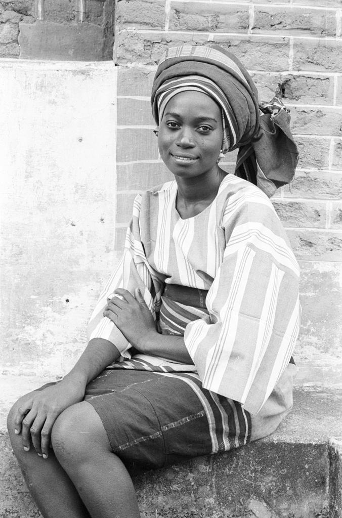 Yoruba woman wearing headtie of her own creation, Ife, Nigeria, 1970. Photo Eliot Elifoson.